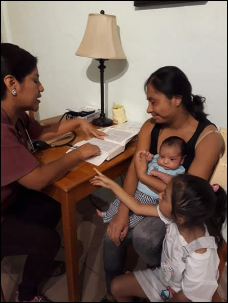 Sara Consults with Mom and Baby